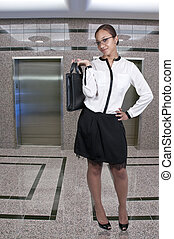 Business Woman - A beautiful young African American upwardly...