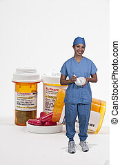 Doctor and Bottle of Prescription Pills - Woman doctor and...