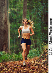 Woman Running in the Forest