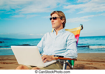 Business man on the beach - Young Business Man Working...