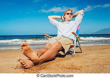 Business man on the beach - Young Business Man Relaxing on...