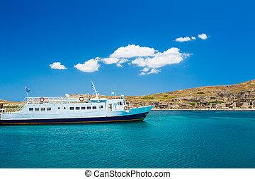 Boat in Greek Islands - Boat in Beautiful Blue Ocean in...
