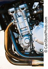modern motorcycle engine detail with chrome exhaust