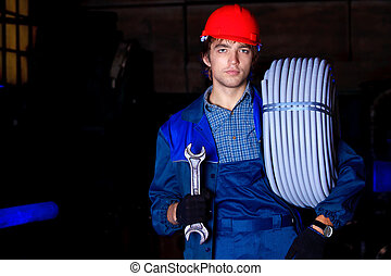 iron industry - Industry: a worker at a manufacturing area.