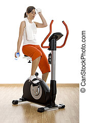 Gym exercise - Young woman tired of training on exercise...