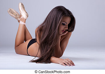 sexy girl with long hairs lay in ballet tiptoe topless
