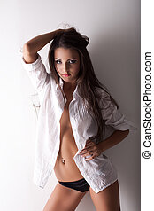 beauty young woman topless posing in shirt - sexy young...