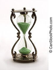 Time is passing - Isolated retro hourglass with green sand