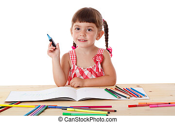 Little girl draw with crayons