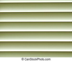 Green closed jalousie at day illumination
