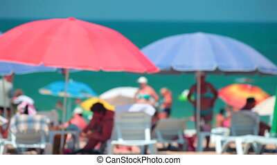 Beach Holidays - Anonymous people enjoying a sunny day at...