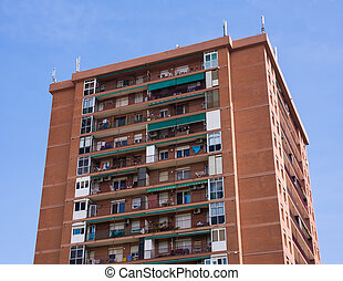 Brown Apartment Building with balconies