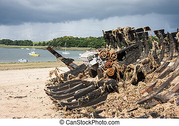 Burned ship wreck at coast of Brittany, France