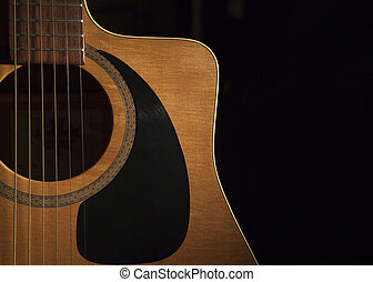 acoustic guitar - a close up view of a acoustic guitar on a...