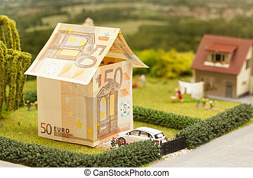 Euro house scenery - a euro bill house in a green...