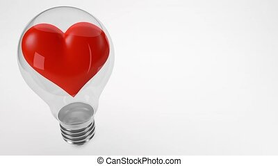 red heart spinning in light bulb