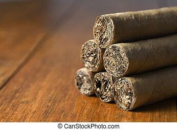 cigars habanos huddled on wood background - cigars habanos...