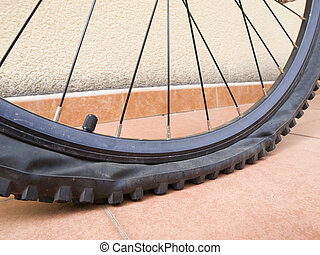 Detail punctured bicycle wheel - Closeup of a mountain bike...