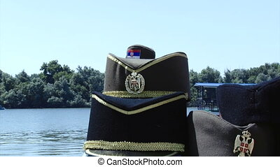 Serbian traditional hats, river in background