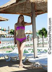 sexy woman in beautiful pink bikini