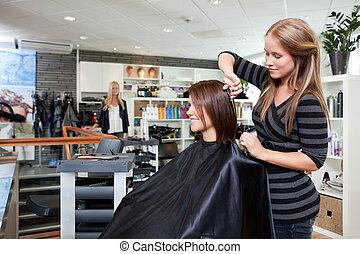 Hairdresser Thinning Customer's Hair
