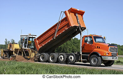 dump truck and grader doing highway construction