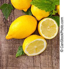 Fresh fruit - Fresh lemons on wooden table, top view