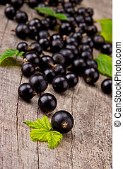 Fresh fruit - Fresh black currant on wooden table