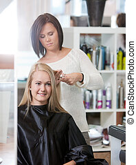Woman at the Hairdresser Salon - Young woman at the...
