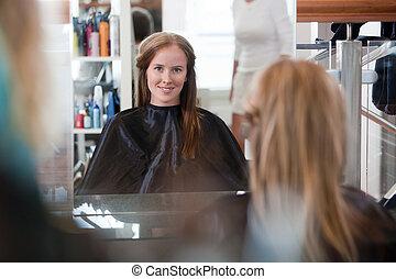 Women at Beauty Salon - Women looking in mirror at beauty...