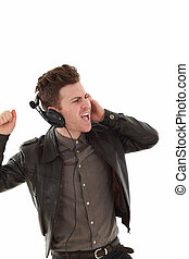 Young adult male louding and listening music