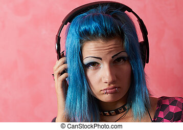 Punk girl DJ with dyed turqouise hair - Her face shows that...