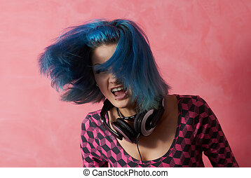 Punk girl DJ with dyed turqouise hair - She's rocking hard...