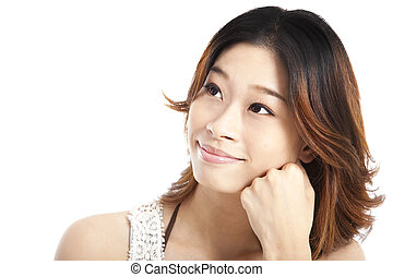 young smiling woman thinking and looking