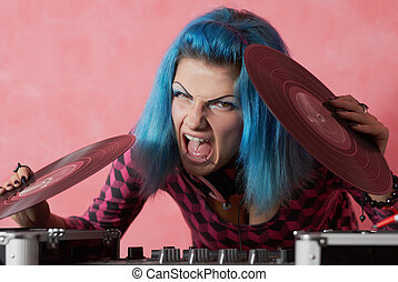 Punk girl DJ with dyed turqouise hair - She looks tough and...