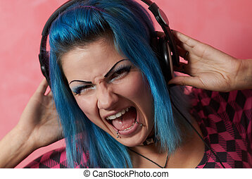 Punk girl DJ with dyed turqouise hair - This music track...