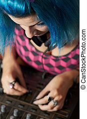 Punk girl DJ with dyed turqouise hair - Cute female disc...