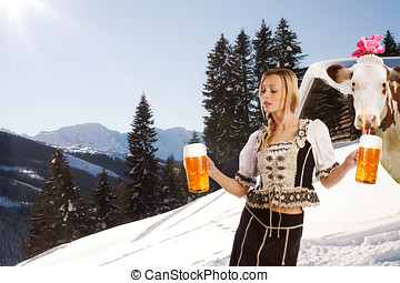 sexy woman in snow and mountains serving beer - funny image...