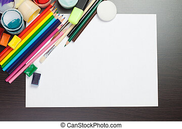 blank sheet of paper with colorful artist instruments...