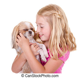 Girl petting her shih tzu dog - A girl holding and petting...
