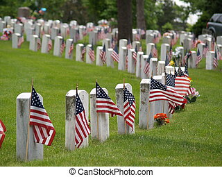 memorial day - Flags placed strategically at each stone to...