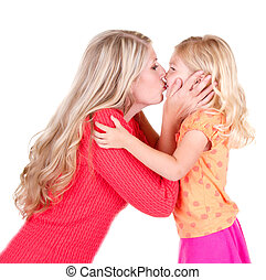 Mother kissing daughter - Mother kissing young daughter,...