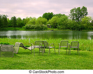 chairs in park overlooking the lake - An idyllic place near...