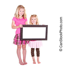 Two girls holding a blank frame