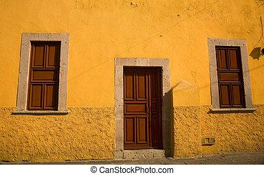 Yellow Adobe House Brown Doors Morelia Mexico