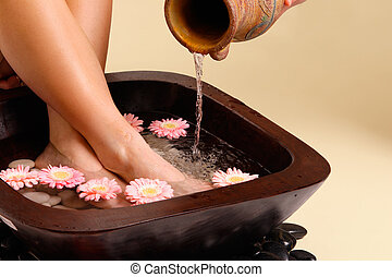Soothing foot soak - Water pouring from an earthenware pot...