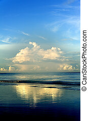 Whispy Clouds Reflecting on Sea - Early morning light on...