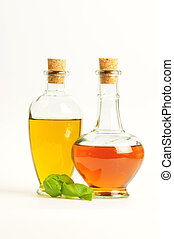 Olive Oil and Vinegar with Basil isolated over white...