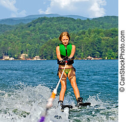 Girl on Trick Skis - Girl on skis getting ready to do a...