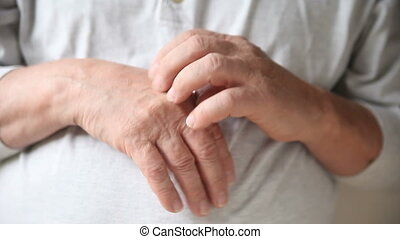 man scratching hand - a man scratches the eczema on his skin